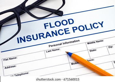 Food insurance policy with ballpoint pen and glasses.