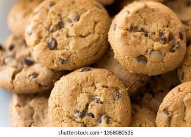 food, junk-food and eating concept - close up of oatmeal cookies with chocolate chips on plate