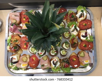 Food kattering on silver plate.