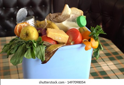 Food Loss and Waste Reduction. Leftovers from a meal, expired food, stale food, and blemished fruits and vegetables in the trash bin. Concept of zero waste and caring for environment