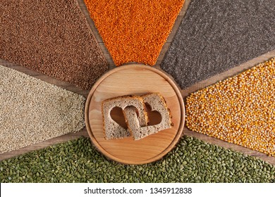 Food with love. Healthy whole grain food with bread slices forming interlocked hearts - surrounded by colorful grains and seeds
