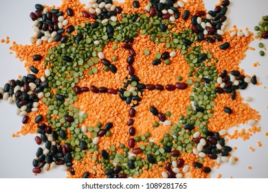 Food mandala with red kidney Beans, white Beans, black Beans, green Peas, red Lentils. Flat lay made of food ingredients: pea, lentils, bean.