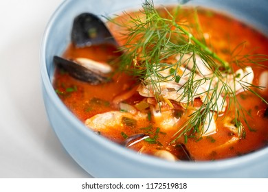 food, new nordic cuisine, culinary and cooking concept - close up of seafood soup with fish and blue mussels in bowl