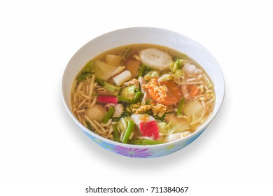 Food - noodle soup style Thaifood in White bowl. The soup boil for a long time. Add Ball meat and vegetables. Season with fish sauce, sugar and pepper. Very popular in Asian and Thailand.