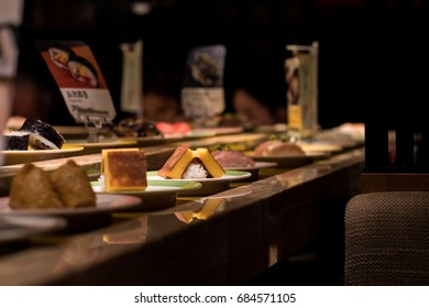 Food on conveyor belt in sushi restaurant in Kyoto, Japan
