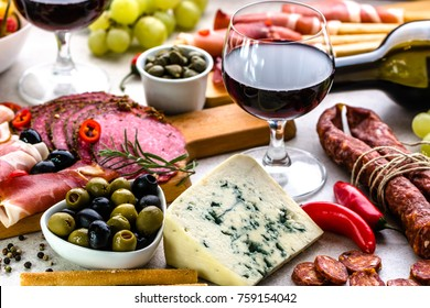 Food on table. Wine snack set, olives, cheese and other appetizer, italian antipasti selection
