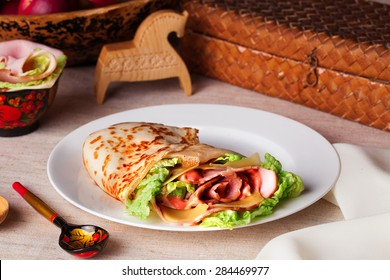 food pancake ham cheese lettuce and sauce on a plate in a still life rustic