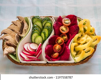 Food pannier with delicious and different  vegetables with delicious tomatoes, pieces of sliced cucumbers and different salad. Appetizer, up side view