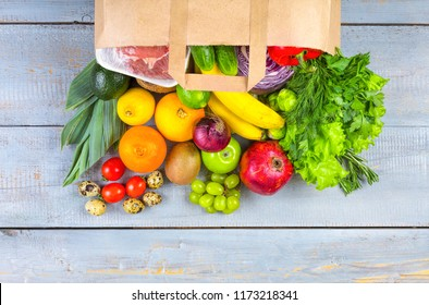 food paper bag with various useful foods from the supermarket