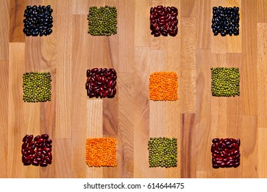 Food pattern with grain squares on wooden board