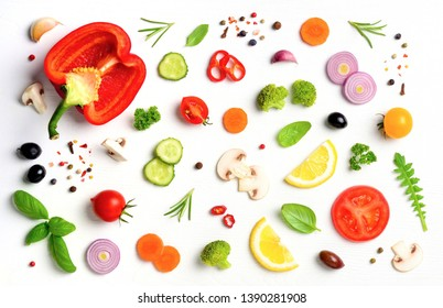 Food pattern with raw fresh ingredients of salad on white wooden background. Top view.