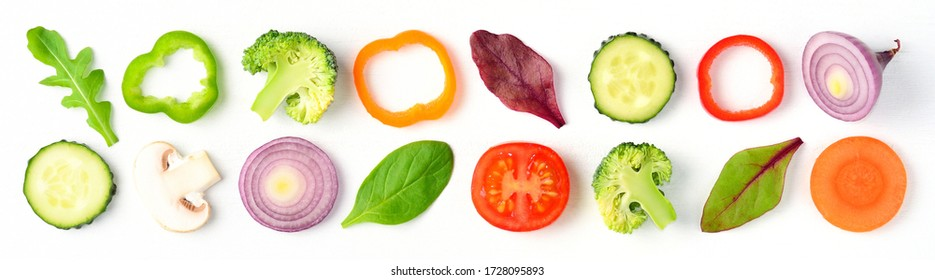 Food pattern with raw fresh ingredients of salad - tomato, cucumber, onion, herbs and spices. Vegetables isolated on white background. Healthy eating concept. Flat lay, top view.
