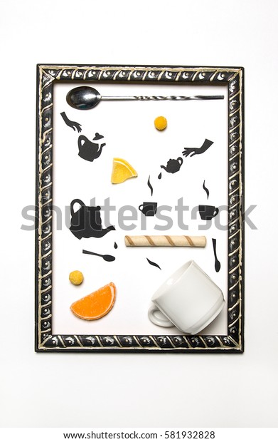 Food photo with candies and black flat objects from black paper