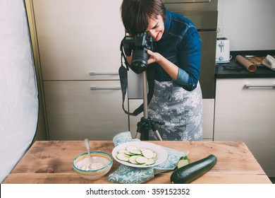 Food photographer taking still life pictures in the kitchen