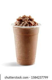 Food photography of chocolate slushie slushy frappe in clear plastic take away cup on white background