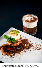 Food photography concept. Breakfast with coffee with milk and shu dessert in cafe, shu cake and coffee with cream, coffee break set with copy space background