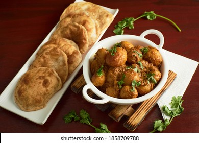Food photography of fresh aloo dum with puri  - Shutterstock ID 1858709788