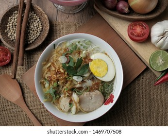 Food photography, Indonesian chicken soto or soto ayam served with ketupat or lontong, Indonesian traditional chicken soup
