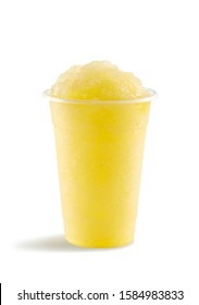 Food photography of pineapple slushie slushy frappe in clear plastic take away cup on white background