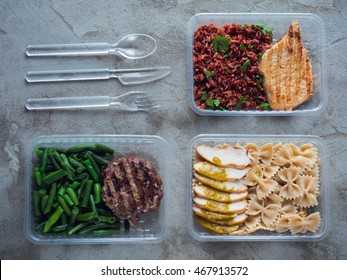 Food in plastic boxes, Daily meal plan delivery service. Fitness food cooked: pork with brown rice, beef with green beans, pasta with chicken