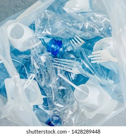 Food plastic packaging in plastic bag.  Concept of Recycling plastic and ecology. Flat lay, top view
