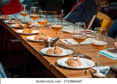 food in plates on a table with wine