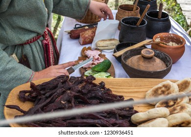 Food preparation, a bun with meat on a historical festival