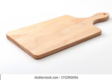 Food preparation tool and kitchen utensils concept with close-up on rectangular wood chopping board with round corners isolated on white background at an angle perspective with clipping path cutout