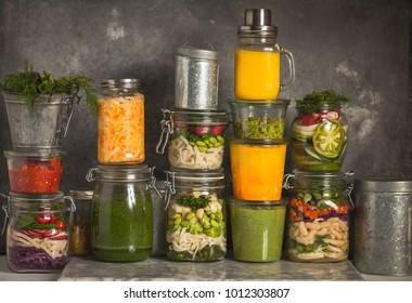 Food prepping vegetarian food in jars menu plan plant based menu storage concept