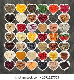Food to promote heart health with fresh fish, vegetables, fruit, seeds, nuts, cereals, grains, herbs and spices. High in omega 3 fatty acids, antioxidants, smart carbohydrates, fibre and vitamins.