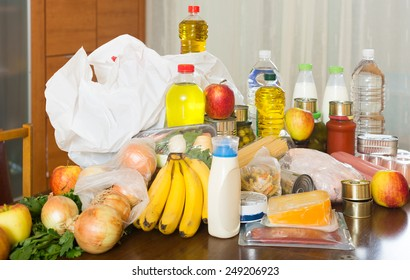food purchases  on table in home