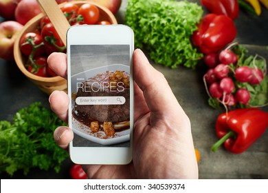 Food recipes smart phone on rustic wooden table