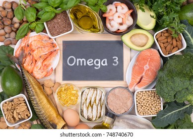 Food rich in Omega 3 fatty acids, top view with a small blackboard