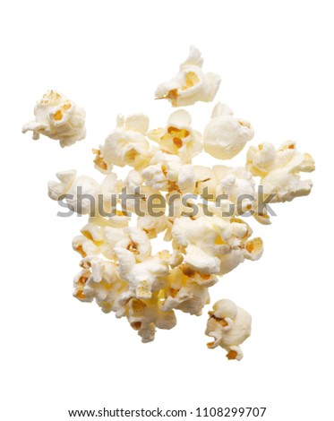 Food: scattered popcorn, isolated on white background