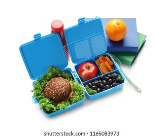 Food for schoolchild in lunch boxes on white background