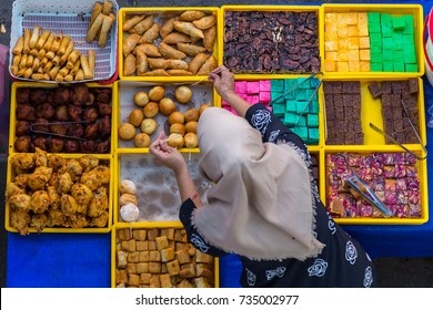 "food seller preparing those delicious and colorful Malaysian home cooked local cakes or ""KUEH' for sale in food stall Market at Kota Kinabalu, Sabah"