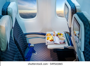 Food served on board of airplane on the table.