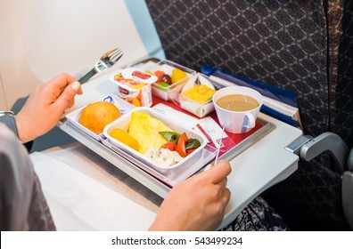 Food served on board of economy class airplane on the table.