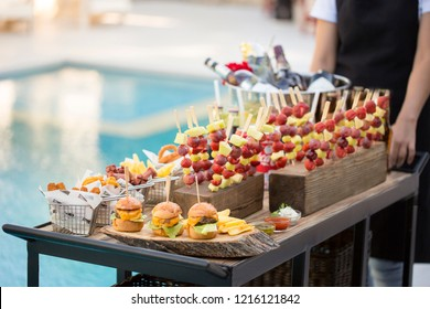 Food serving cart with delicious various of snacks, ready for party.