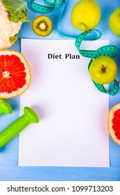 Food and sheet of paper with a diet plan on a blue wooden background. Concept of diet and healthy lifestyle.