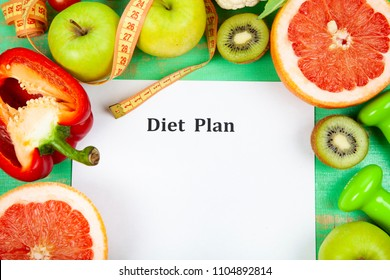Food and sheet of paper with a diet plan on a green wooden background. Concept of diet and healthy lifestyle.