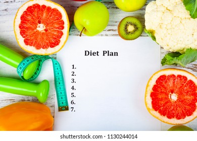 Food and sheet of paper with a diet plan on a wooden background. Concept of diet and healthy lifestyle.