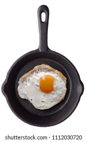 Food: single fried egg on a black frying pan, isolated on white background