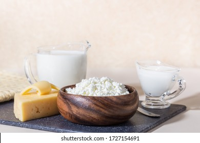 Food is a source of calcium, magnesium, protein, fats, carbohydrates, balanced diet. Dairy products on the table: cottage cheese, sour cream, milk, cheese, contain casein, albumin, globulin, lactose