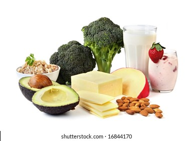 Food sources of calcium, isolated on white.  Includes milk, yogurt, almonds, cheeses, broccoli, salmon, and avocado.