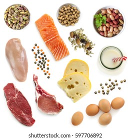 Food sources of protein, isolated, top view.  Includes meat, fish, dairy, beans, nuts and seeds.