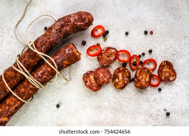 Food from spain, chorizo sausage slices or salami pepperoni, traditional spanish tapas, overhead.