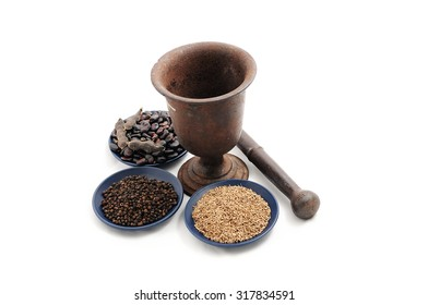 Food still life vintage pestle and mortar with flax seeds,black pepper and beans on blue plate isolated on white background