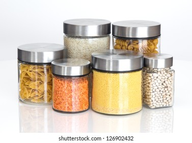 Food storage. Food ingredients in glass jars, on white background.