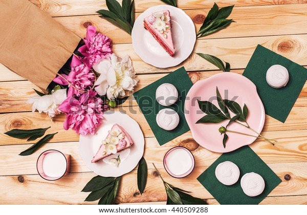 Food, food styling, cooking. Pink cakes, zephyr on napkins with peonies